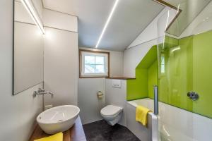 Ein Badezimmer in der Unterkunft Hof Mazenau