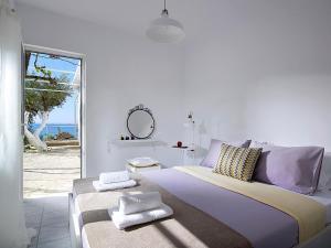 A bed or beds in a room at Pelagaios Villas