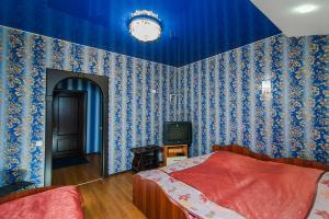 A bed or beds in a room at Baza otdyha Dikiy Ray