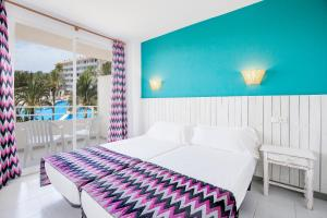 A bed or beds in a room at Club B by BH Mallorca - Adults only