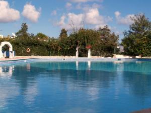 The swimming pool at or near Siesta Mar