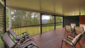 A balcony or terrace at Mapleton Falls Accommodation