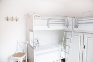 Divstāvu gulta vai divstāvu gultas numurā naktsmītnē Residence Margerithenweg