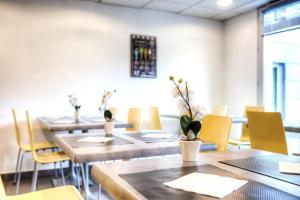 Restaurant ou autre lieu de restauration dans l'établissement Zenitude Hôtel-Résidences La City