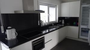 Een keuken of kitchenette bij Postwiese 21A