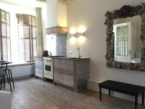 A kitchen or kitchenette at P. Stuyvesant Suite