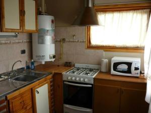 Una cocina o kitchenette en Nuevos Vientos
