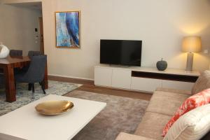 A television and/or entertainment center at LoftAbroad Premium Apartments