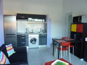 A kitchen or kitchenette at Appartement Jara