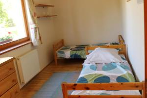 A bed or beds in a room at Angelland with Garden