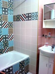 A bathroom at Elegant Apartment