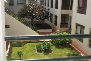 Um jardim no exterior de Cartaia Apartamento Leste
