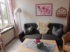 Ein Sitzbereich in der Unterkunft Apartments Schnepel