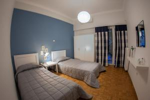 A bed or beds in a room at Lav Athens Apts