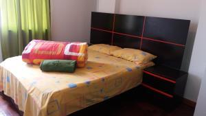 Cama o camas de una habitación en Tikas House Apartment