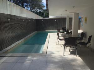 A piscina localizada em Apartamento Capitães de Areia Ilheus ou nos arredores