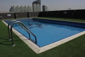 The swimming pool at or near Royal Ascot Hotel Apartment - Kirklees 2