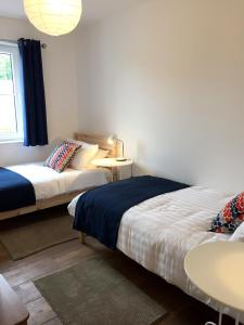 A bed or beds in a room at Casa Ceol