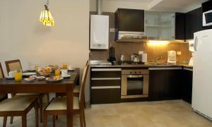 A kitchen or kitchenette at Village Condo