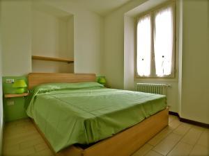 Een bed of bedden in een kamer bij Locanda Posta