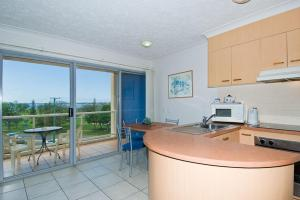 A kitchen or kitchenette at Rays Resort