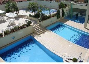 The swimming pool at or near Serra Park Flat Service Thermas Adm