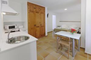 Una cocina o zona de cocina en Apartamentos Gravina