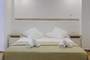 Cama o camas de una habitación en Apartamentos Gravina