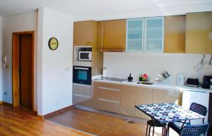 A kitchen or kitchenette at Residences Wine