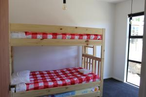 A bunk bed or bunk beds in a room at Number 4