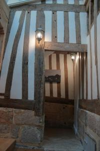 A bunk bed or bunk beds in a room at Logis Saint Eloi