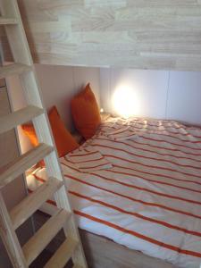 A bunk bed or bunk beds in a room at Studio Zeezicht