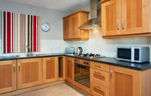 A kitchen or kitchenette at Cordia Serviced Apartments