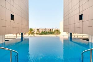 The swimming pool at or near Ramada Hotel and Suites Amwaj Islands