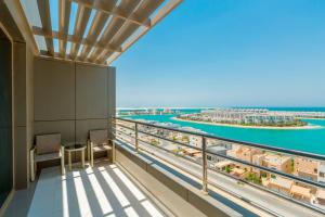 A balcony or terrace at Ramada Hotel and Suites Amwaj Islands