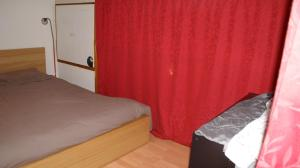 Un ou plusieurs lits dans un hébergement de l'établissement Meublé Tourisme à Metz