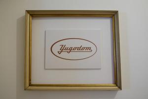 A certificate, award, sign, or other document on display at Retro Yugoslav Museum Lodge
