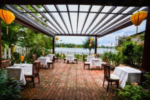 A restaurant or other place to eat at Villa Orchid Garden Riverside