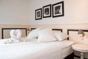 Ein Bett oder Betten in einem Zimmer der Unterkunft Hotel & Appartementen Bella Vista