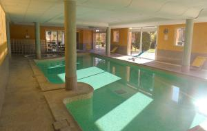 The swimming pool at or near Résidence Odalys La Licorne de Haute Provence