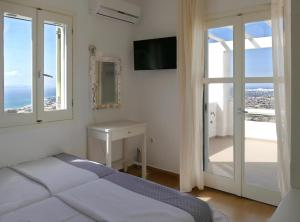 A bed or beds in a room at Villas Naxos Grande Vista