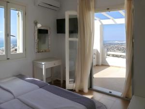 A television and/or entertainment center at Villas Naxos Grande Vista
