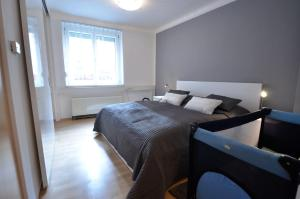 A bed or beds in a room at Appartement Döbling