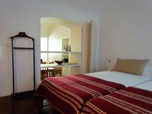 A bed or beds in a room at Casa do Aqueduto da Prata