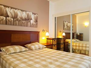 Ein Bett oder Betten in einem Zimmer der Unterkunft Apartments Paraíso del Sur