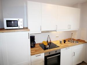 Küche/Küchenzeile in der Unterkunft Lagunenstadt am Haff
