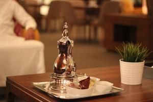 A restaurant or other place to eat at Rafa - Al Nuzhah