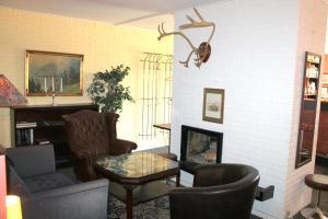 Een zitgedeelte bij Hotel Medio Apartments