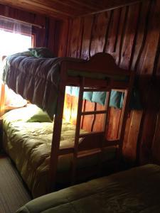 Litera o literas de una habitación en Cabañas donde la Tita Pucon