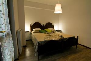 A bed or beds in a room at Apartments Experience